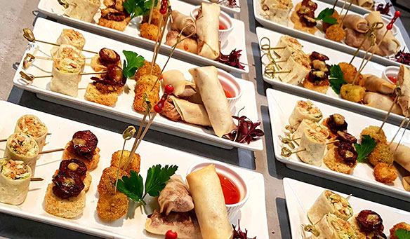 plates of canapes and dipping sauce at a corporate event