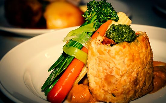 a vegan main meal - vegetable wellington with carrots, broccoli, baby sweetcorn and leeks